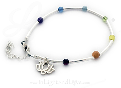 4mm Gemstone Chakra Bracelet shown with an upgraded clasp (Extension Clasp) and they added a charm (Lotus Flower Charm).