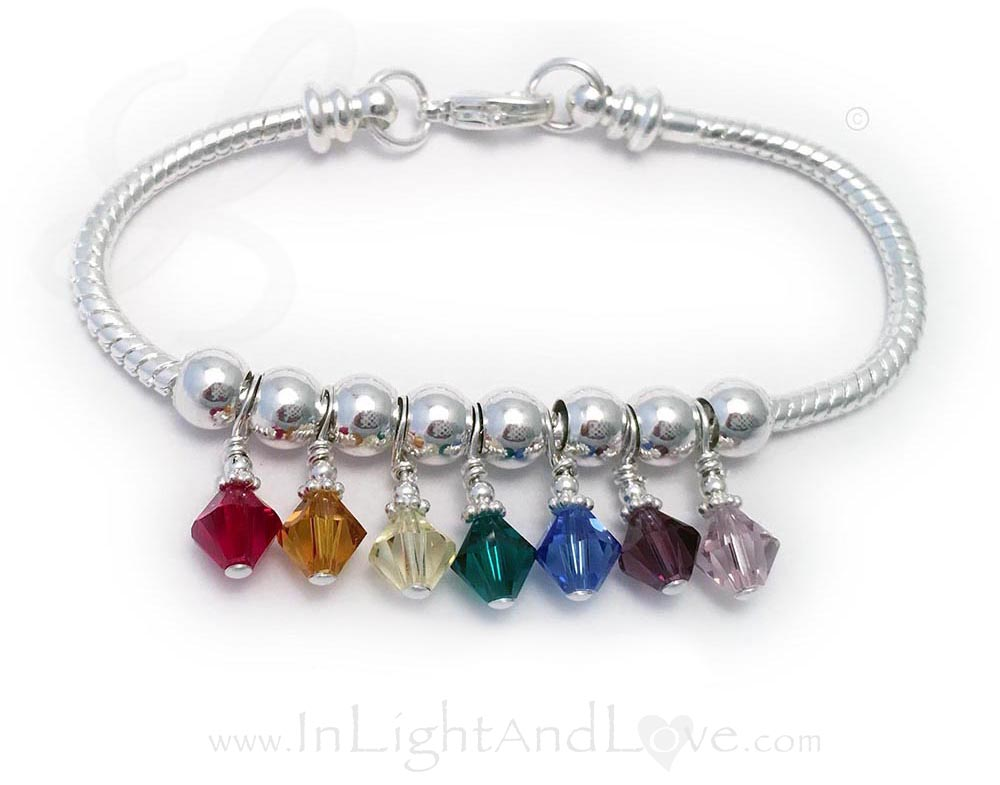 This 3-4mm round Gemstone Crystal Chakra Bracelet™ is made with 3-4mm precious and semi-precious gemstones with each color representing a different chakra and surrounded by beautiful sterling silver tube beads and a sterling silver twisted toggle clasp. The gemstones are Amethyst, Indigo, Aquamarine, Peridot, Cat's Eye, Aventurine and Gar